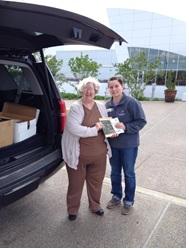 Linda Higgins (L), Jade Walsh, coordinator of donations. Discovery Park of America